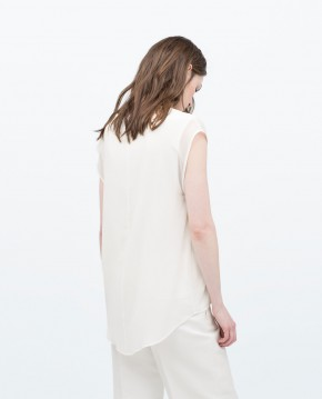 Top with ribbed neckline