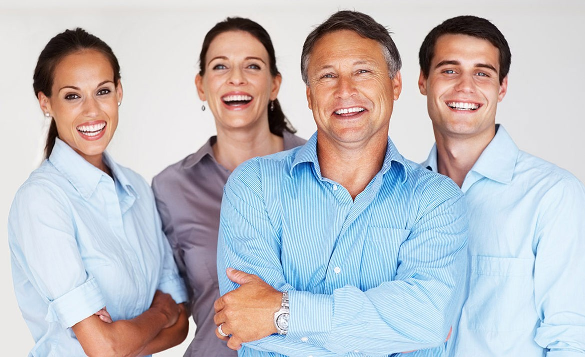 Portrait of business team standing together and smiling