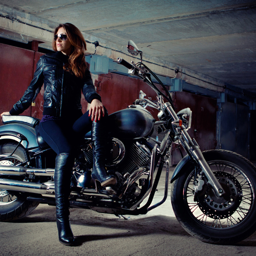Woman is sitting on the motorcycle