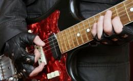 Hands rock musician with a guitar