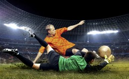 Football player and jump of goalkeeper on the field of stadium a
